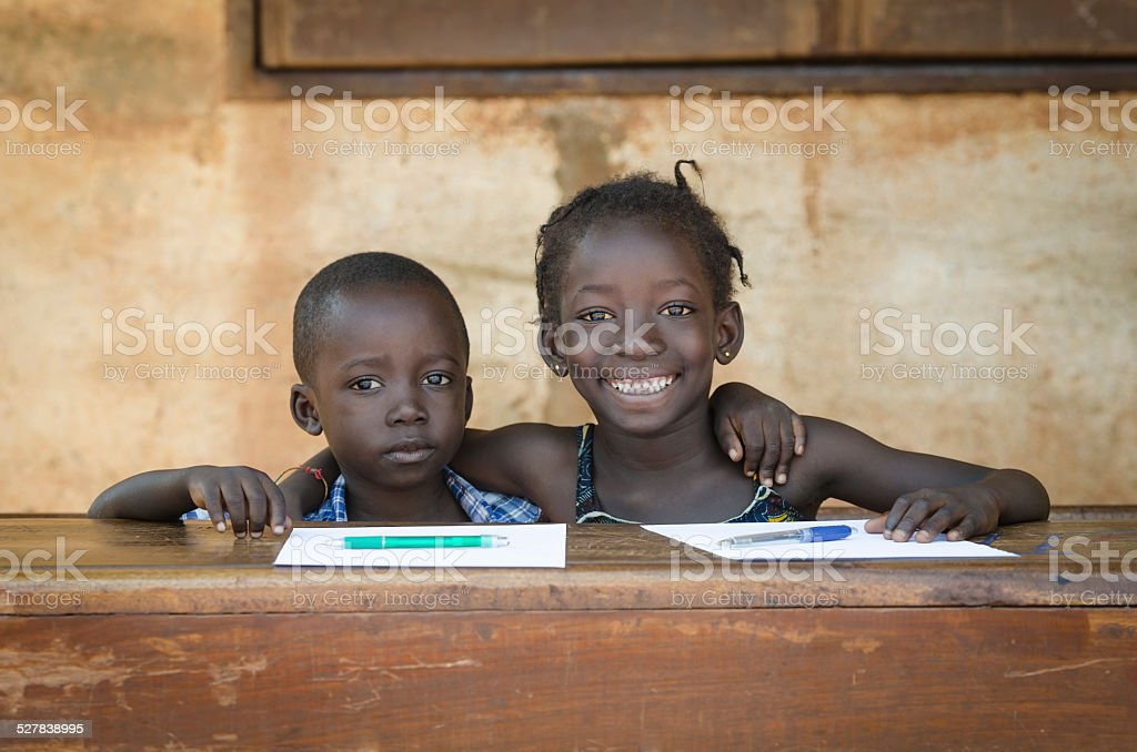 Embracing Education: Couple of African Boy and Girl Smiling School stock photo
