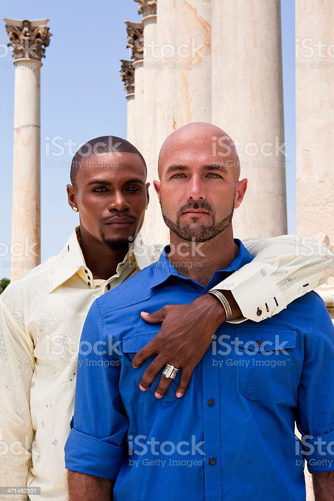 Embracing Gay Couple Looks for Support royalty-free stock photo