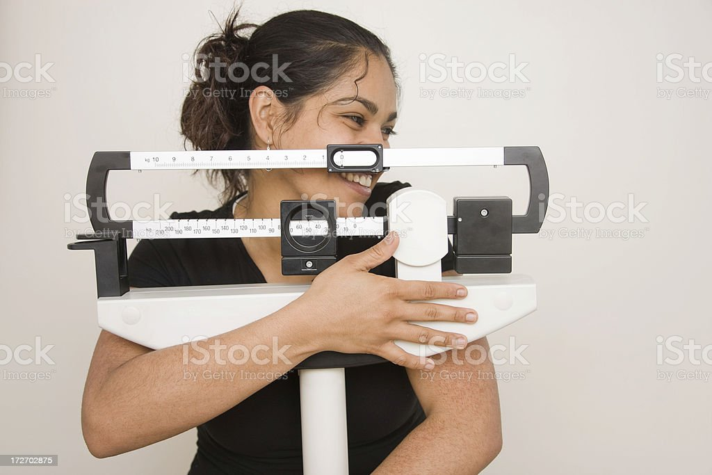 Embracing weight scale royalty-free stock photo