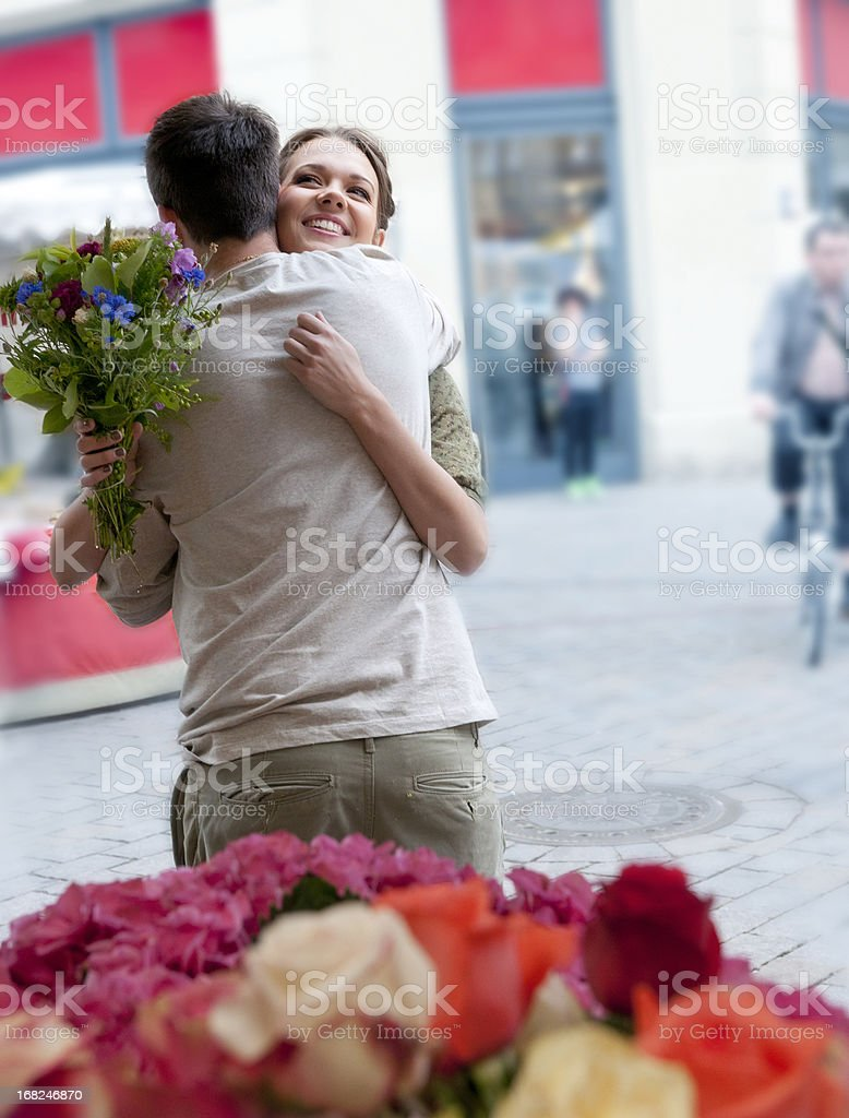 embracing young couple at flower market royalty-free stock photo
