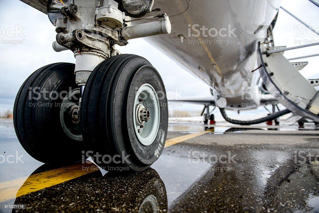 Embraer ERJ 145 aircraft landing gear on the runway stock photo