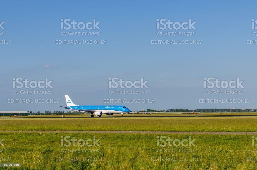 Embraer ERJ-190 of KLM Cityhopper landing at Schiphol stock photo