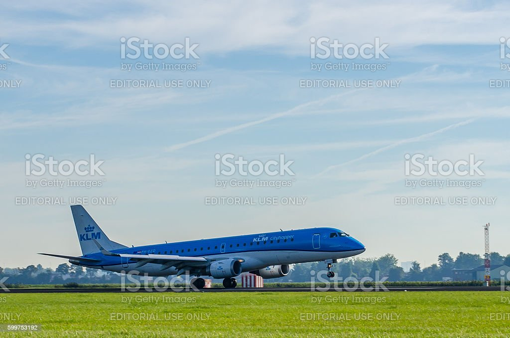 Embraer ERJ-190 of KLM landing at Schiphol Airport stock photo