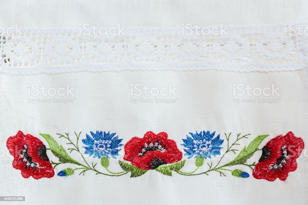 Embroidered floral pattern on a white linen towel stock photo