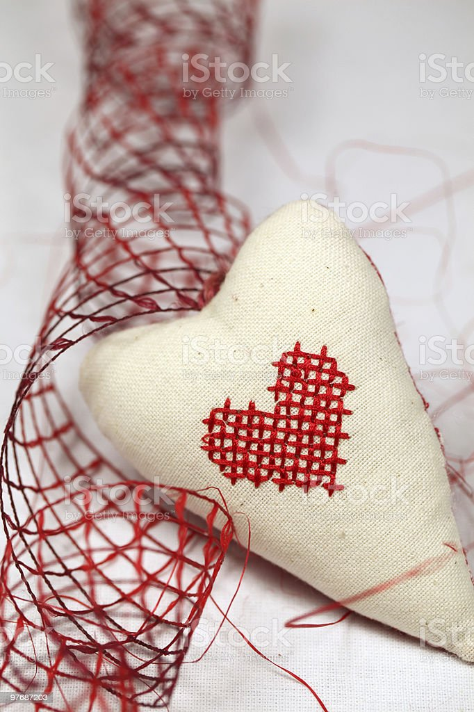 Embroidered heart and ribbon royalty-free stock photo