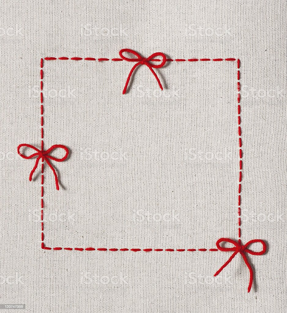Embroidery featuring three ties embroidered with red thread royalty-free stock photo