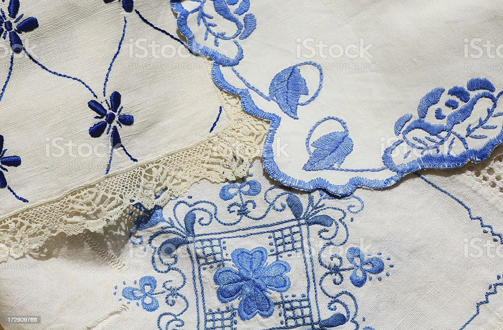 Embroidery in Blue Colors on White Linen royalty-free stock photo