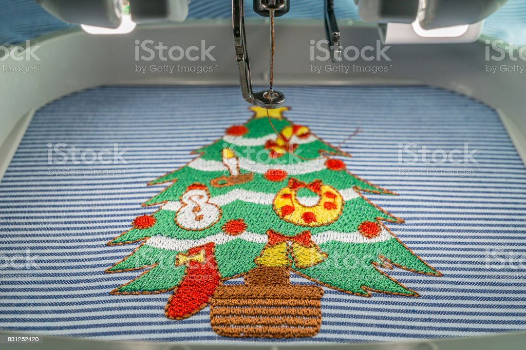 embroidery machine at workspace stock photo