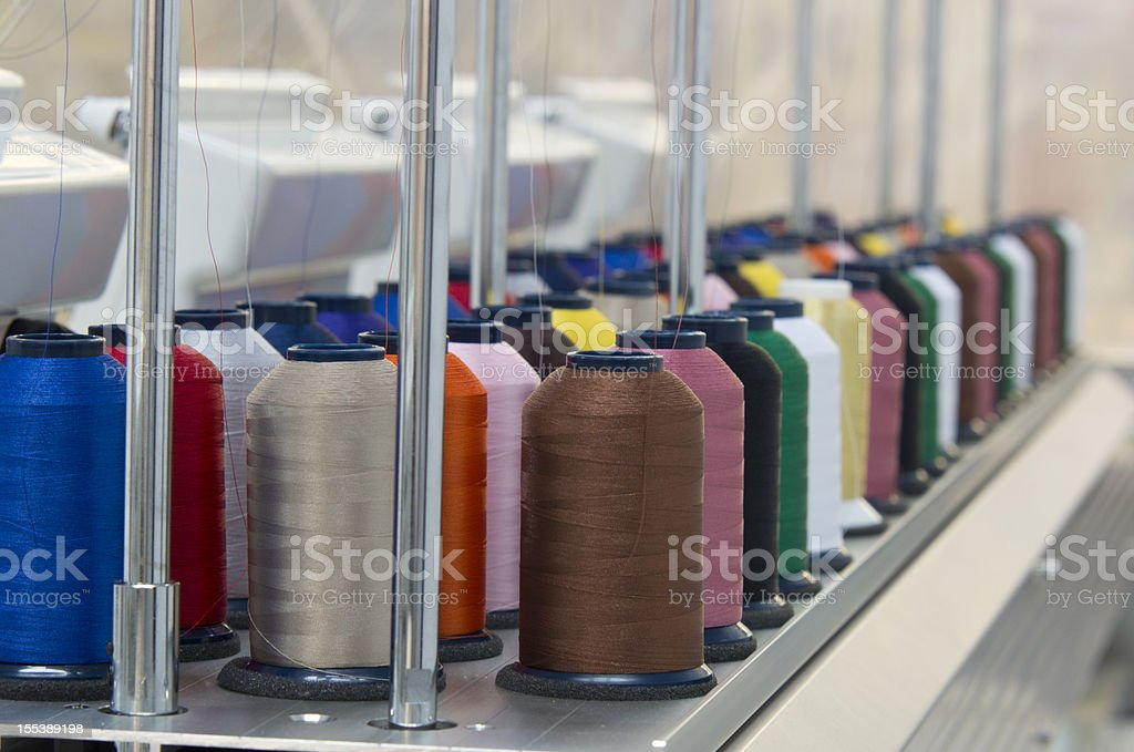 Embroidery spools of thread stock photo