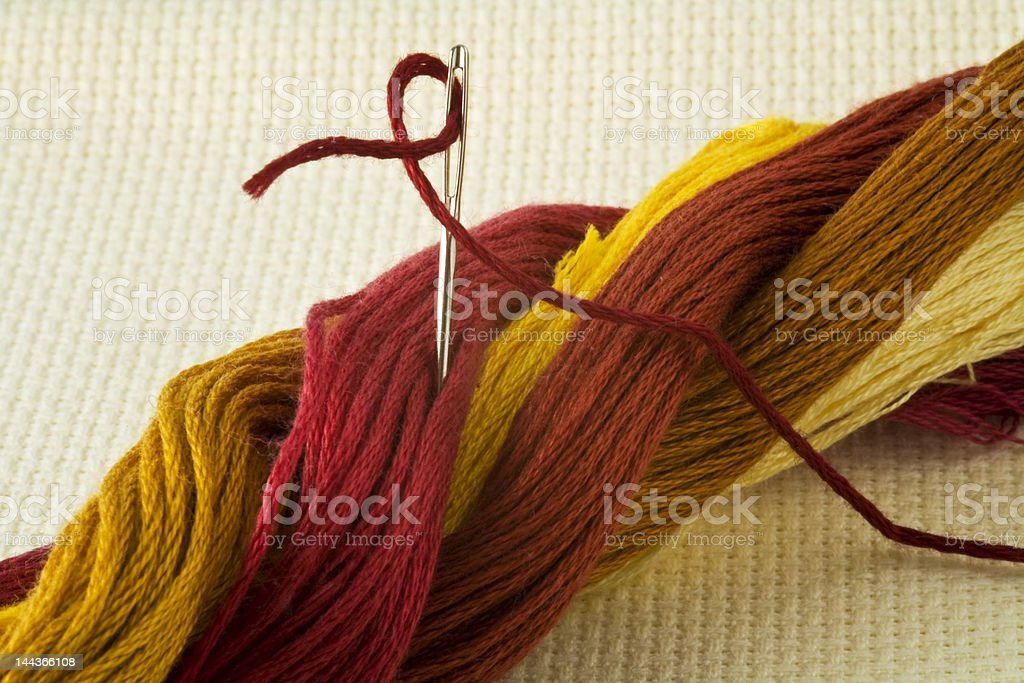 Embroidery threads with needle royalty-free stock photo