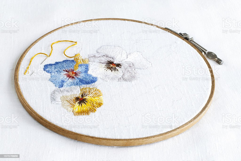 Embroidery with pansy pattern royalty-free stock photo