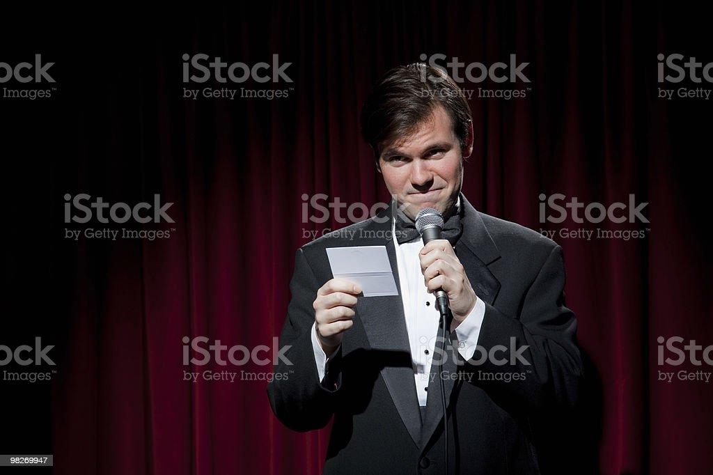 Emcee in tuxedo annoucing the winner stock photo