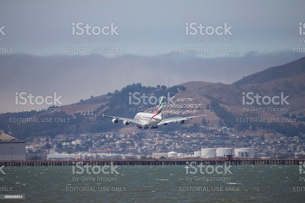 emerald Airline Airplane Landing to San Francisco Airport stock photo