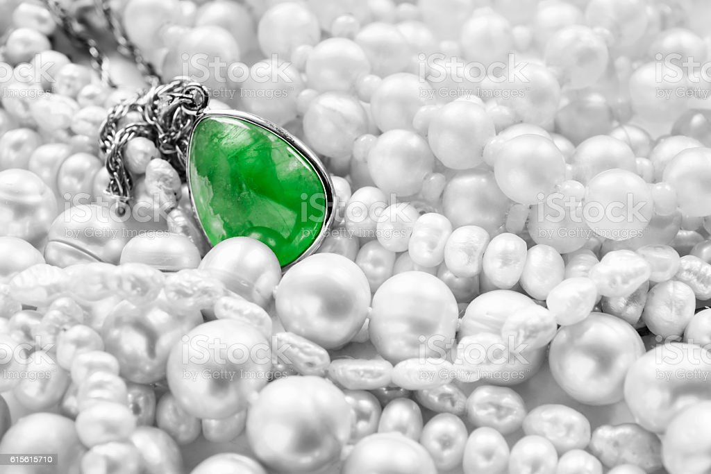 Emerald pendant and pearl stock photo