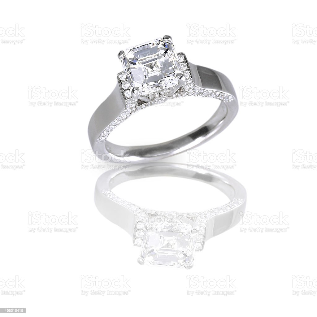 Emerald princess cut diamonds on the side wedding engagment ring. stock photo