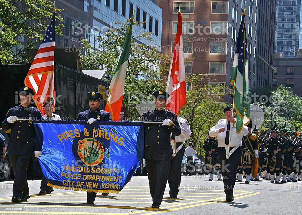 NYPD Emerald Society Pipes & Drums Flag Bearers in Procession stock photo