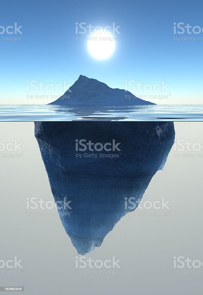 Emerged and submerged parts of an iceberg stock photo