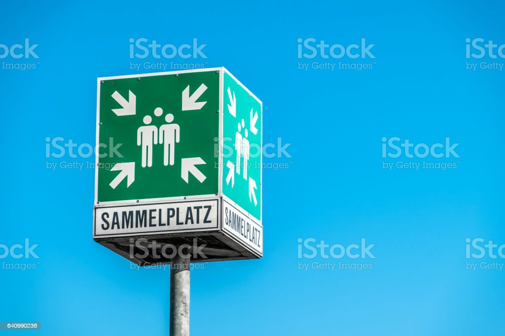 Emergency assembly point sign in German language