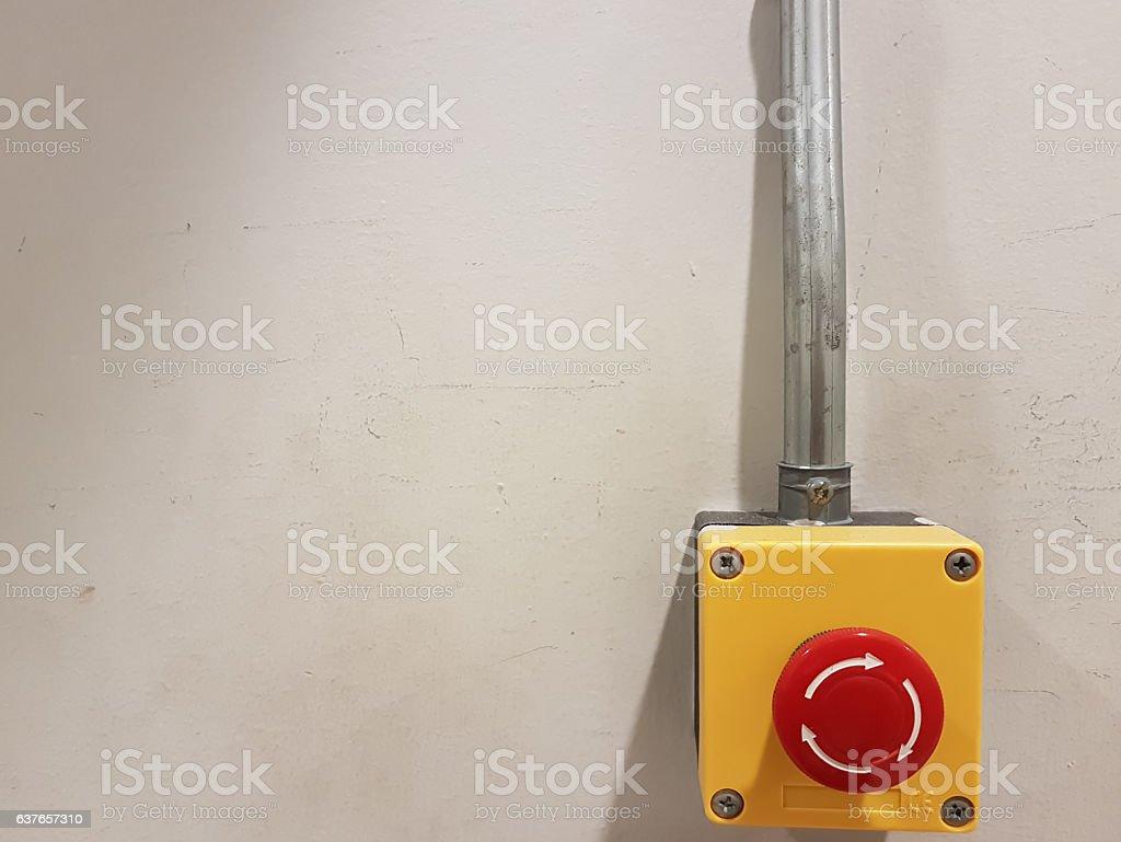 emergency botton on write wall stock photo