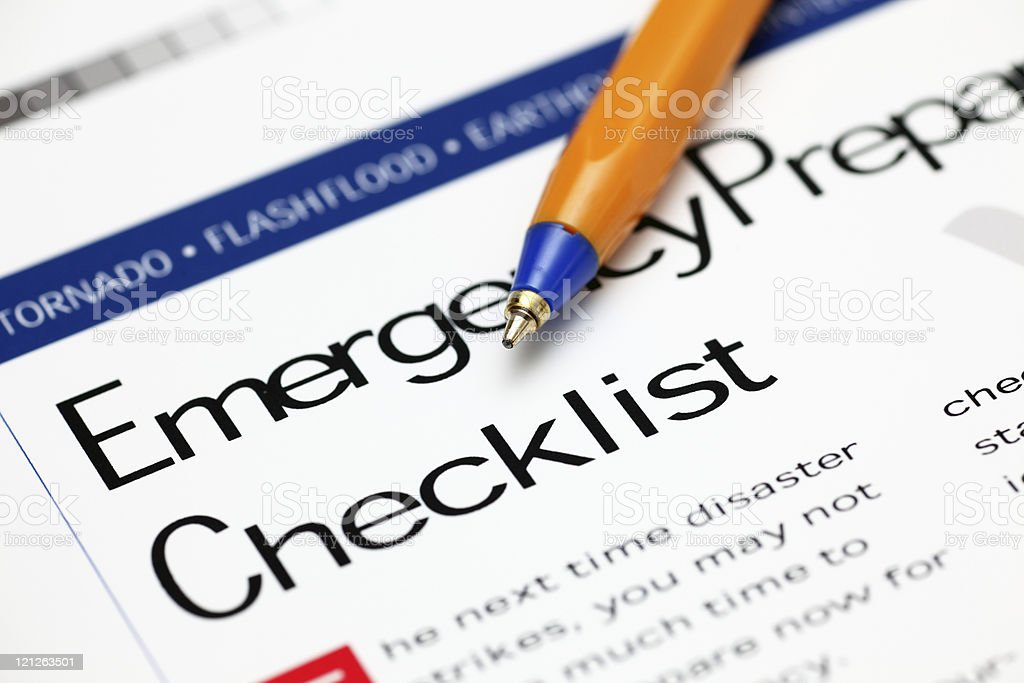 Emergency Checklist and ballpoint pen royalty-free stock photo