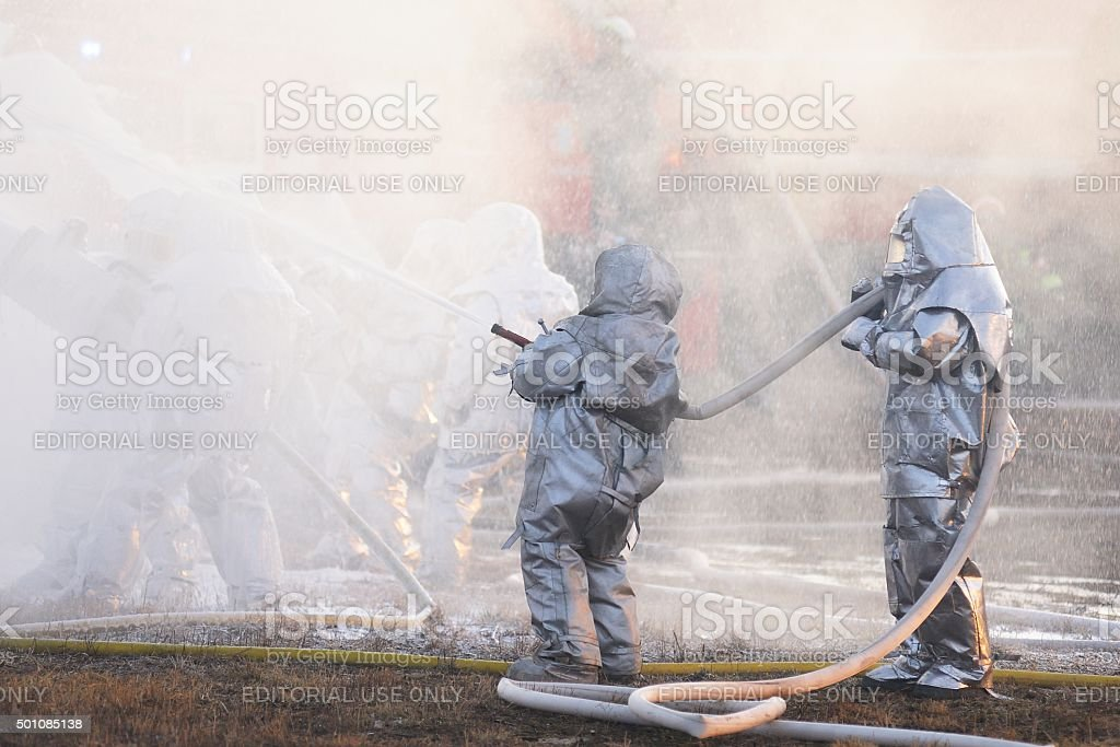 Emergency Control Ministry (MCHS) tactical exercise. Firefighter fighting fire stock photo