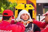 Nine, Portugal - April 12, 2014: Emergency crew immobilizes victim