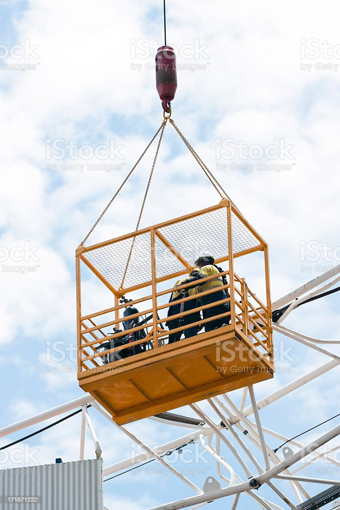 Emergency crew inspecting damages on tower crane, copy space stock photo