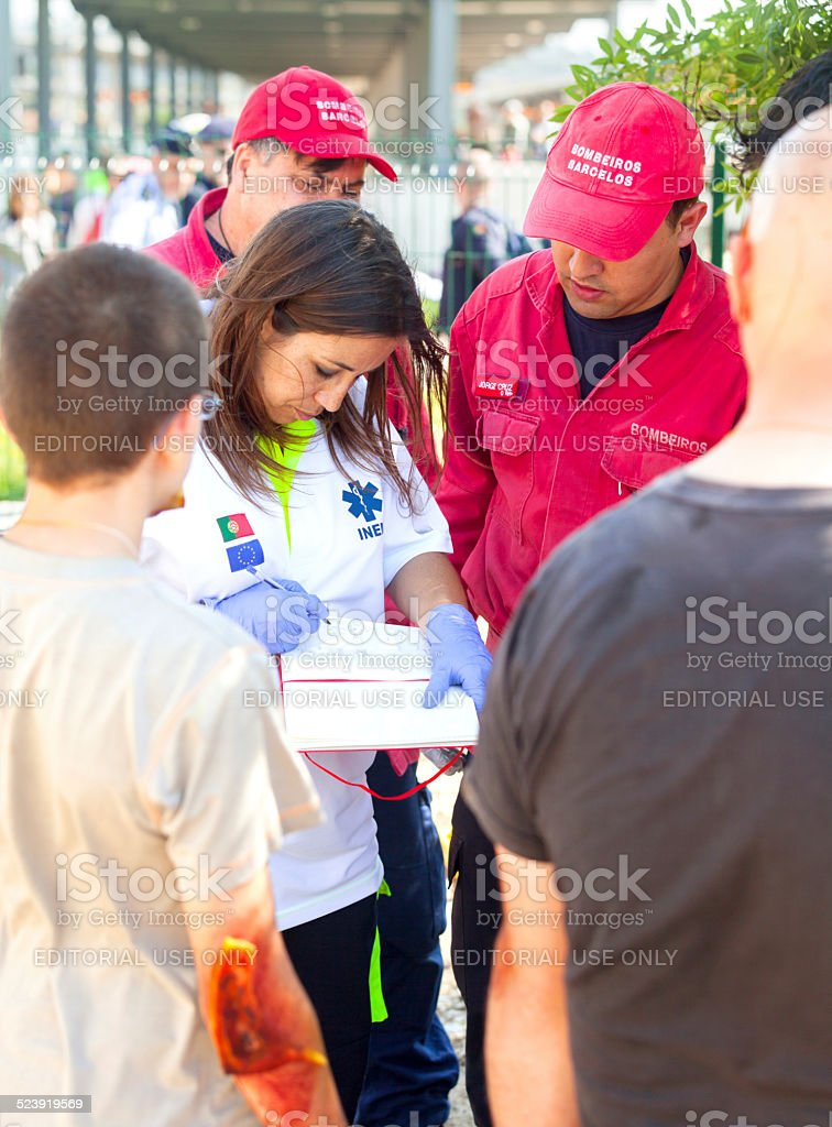 Emergency doctor takes notes of victims situation stock photo