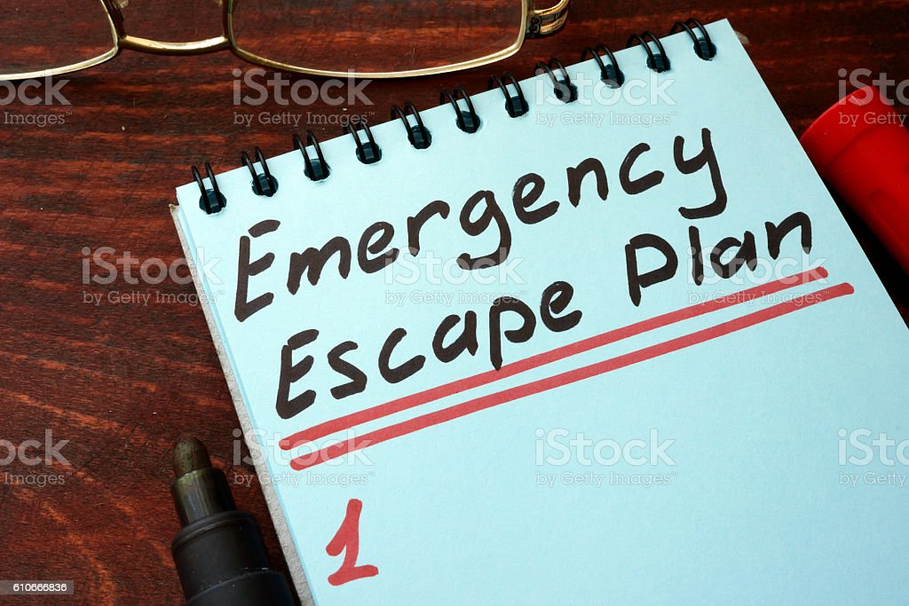 Emergency Escape Plan written on a notepad with marker. stock photo