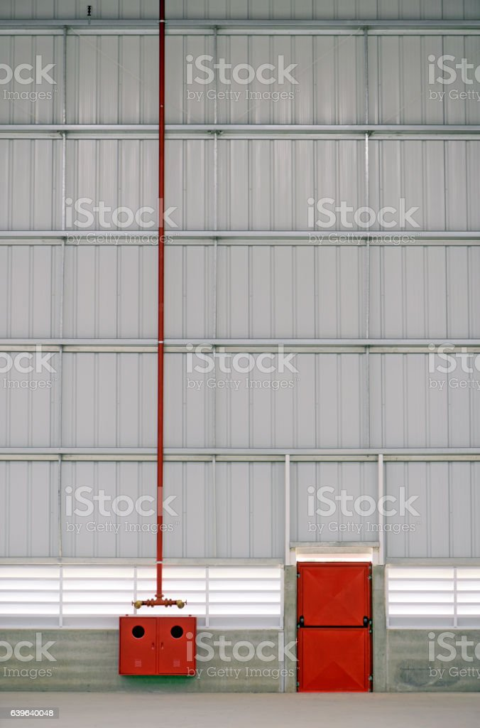 Emergency exit and fire hydrant on an industrial installation stock photo