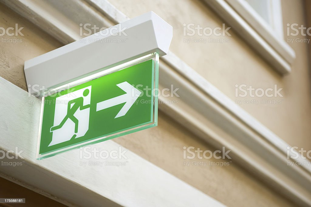 Fire exit light sign in a shopping zonePlease see some similar...