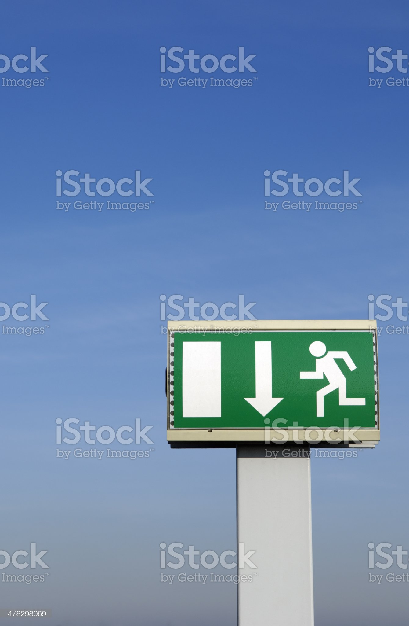 Emergency exit sign and blue sky royalty-free stock photo