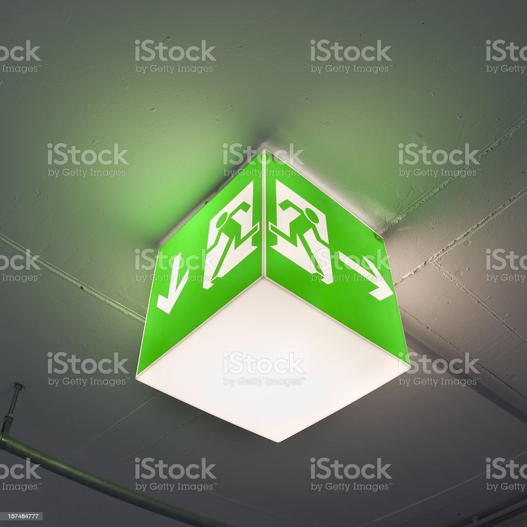 Emergency exit sign, cube light on ceiling, concept royalty-free stock photo