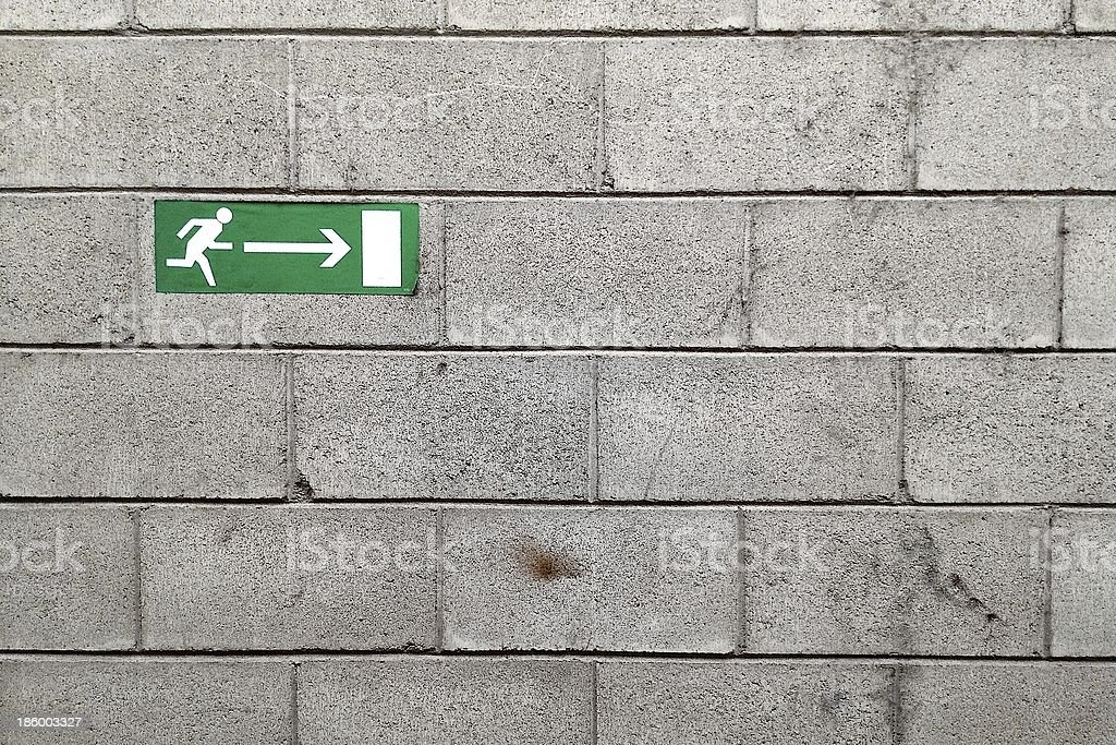 Emergency exit signs on the wall royalty-free stock photo