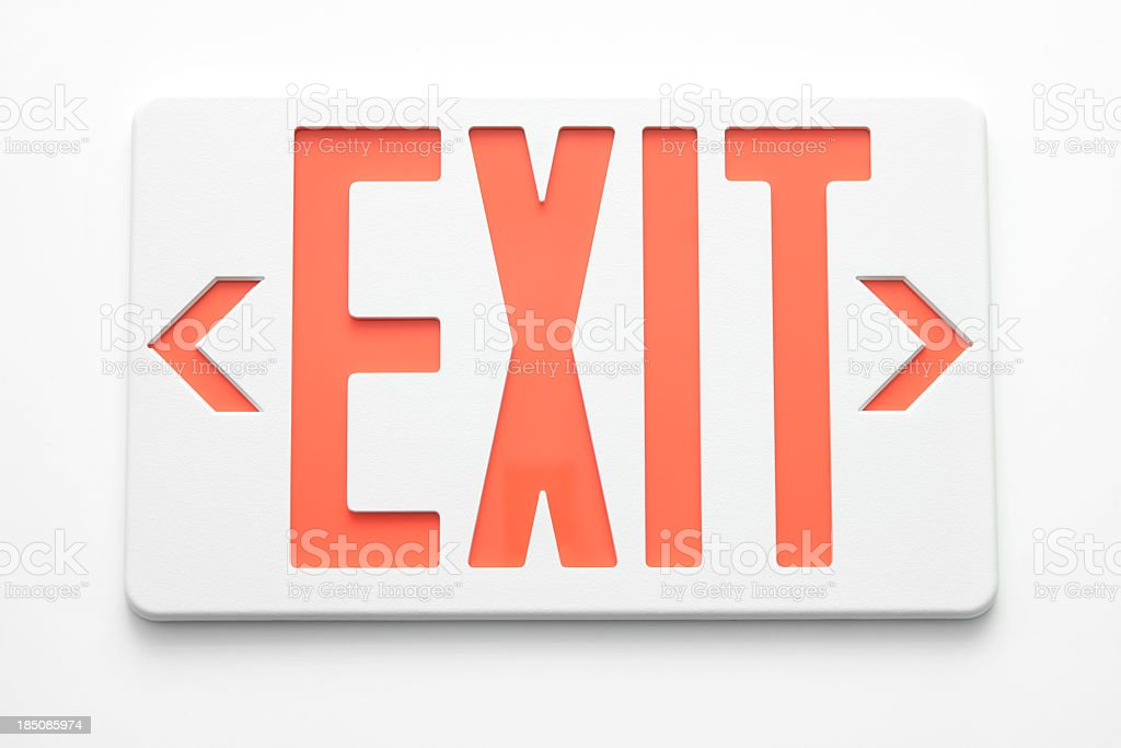 Emergency exit signs on white wall stock photo