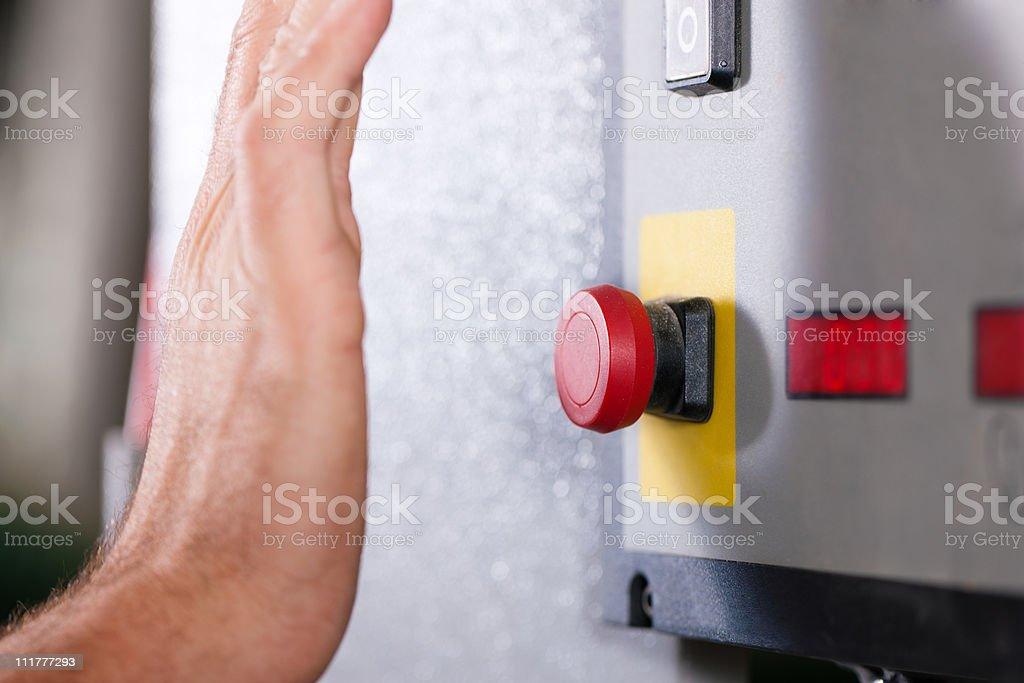Emergency – Man shutting machine of royalty-free stock photo