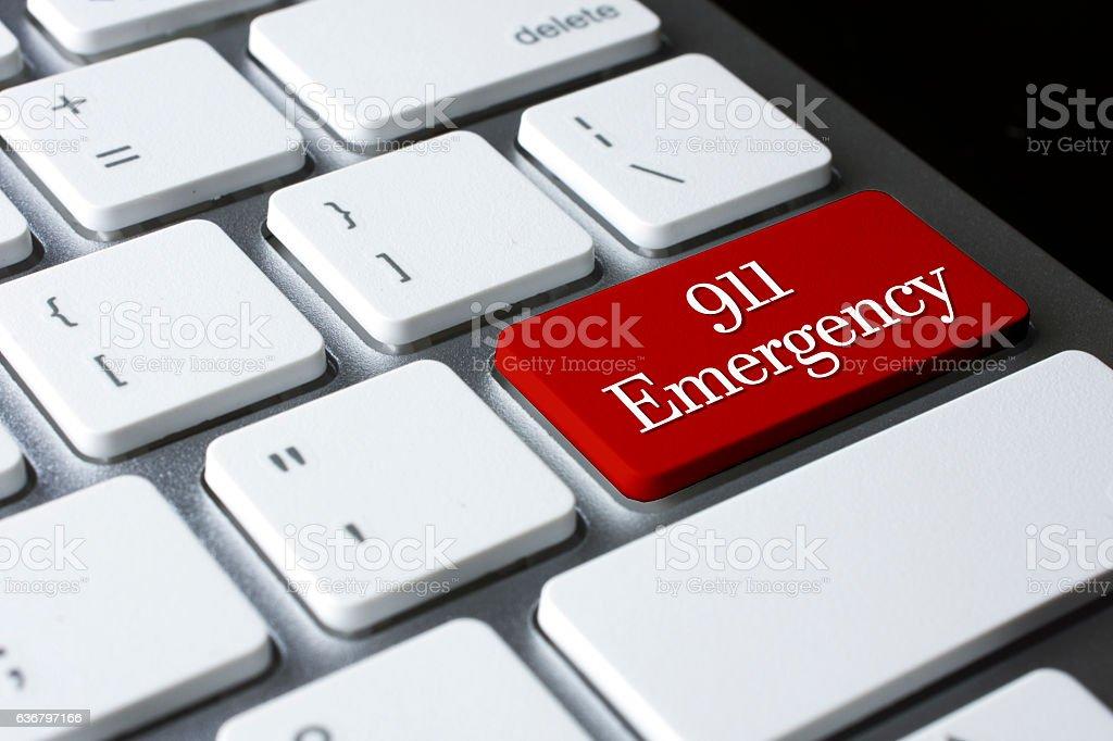 911 Emergency on white keyboard stock photo