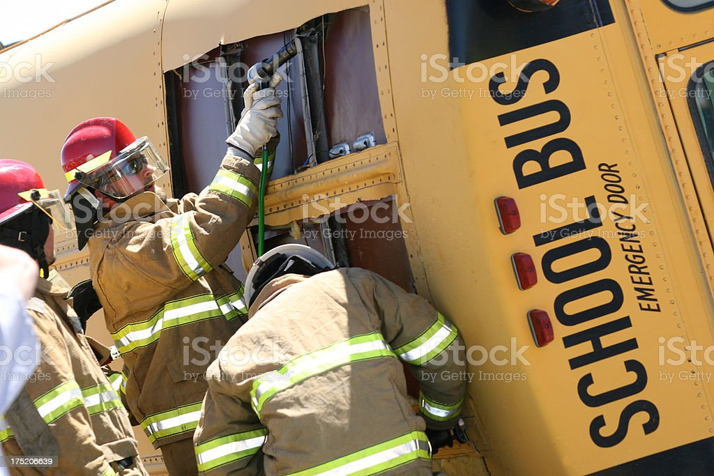 Emergency Personel Extricating Wrecked School Bus royalty-free stock photo