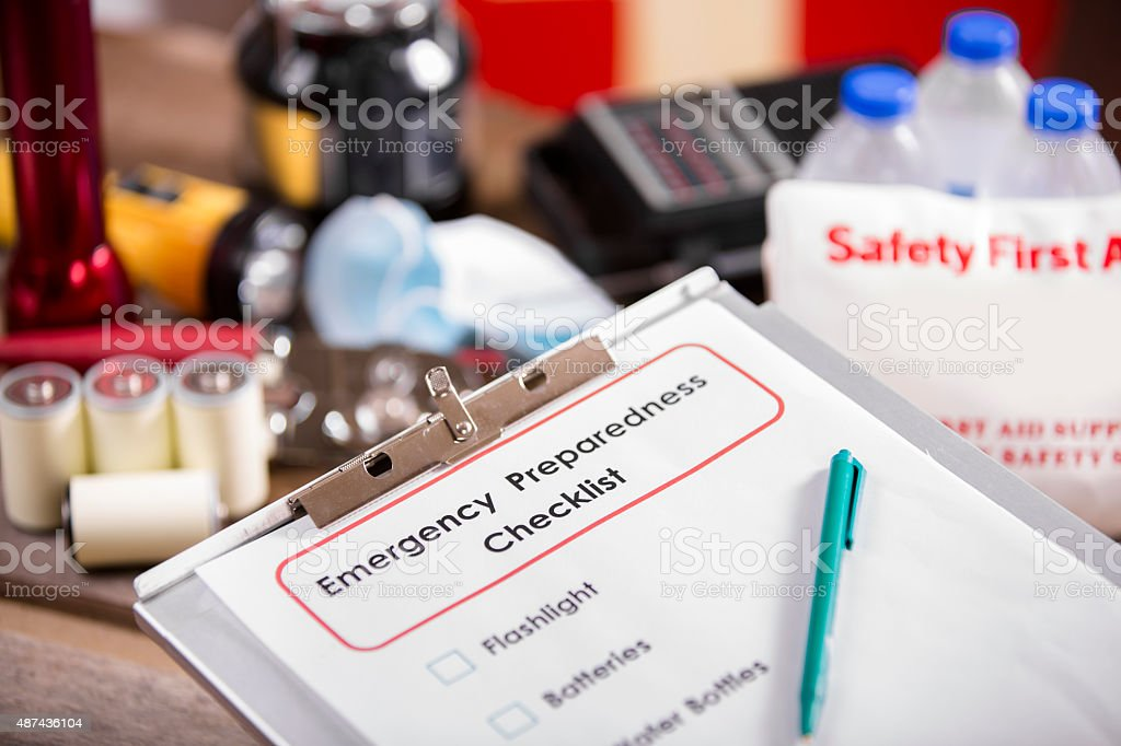 Emergency preparedness checklist and disaster supplies. stock photo