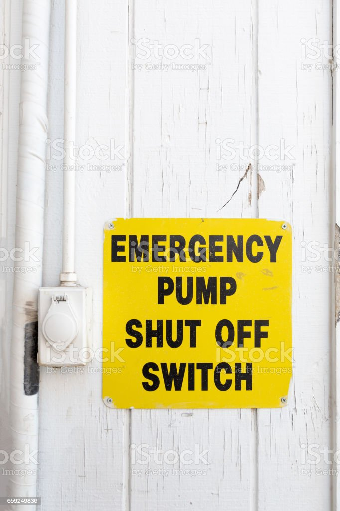 Emergency pump shut off or stop push button switch sign stock photo