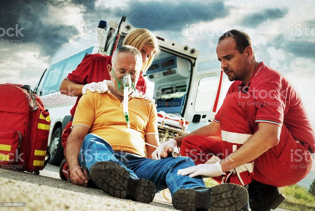Emergency service rescuing an infarcted stock photo