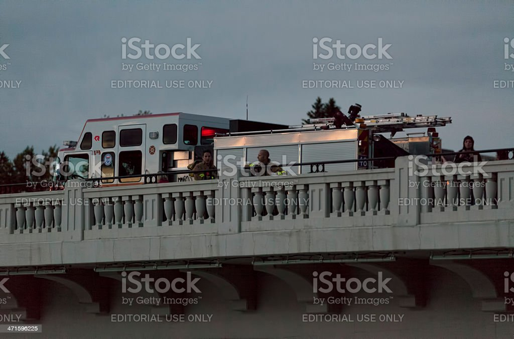 Emergency services surveying the swollen Bow River in Calgary royalty-free stock photo