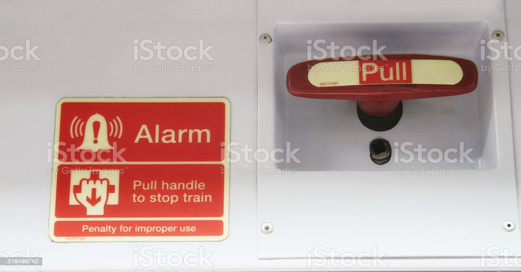 emergency stop alarm and handle on train stock photo