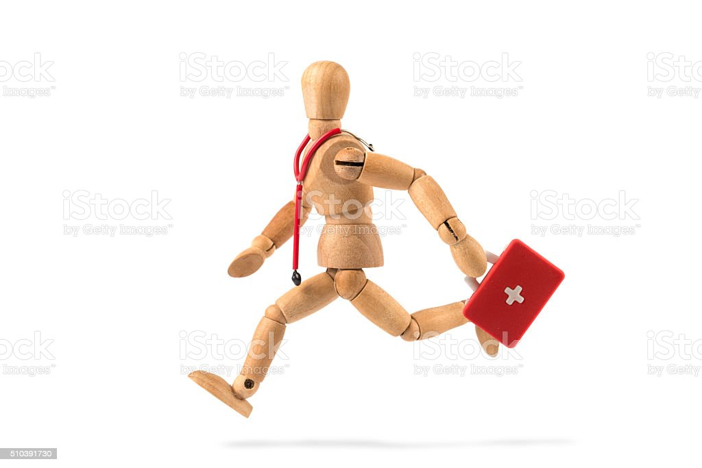 emergency - wooden mannequin runs with first aid kit stock photo