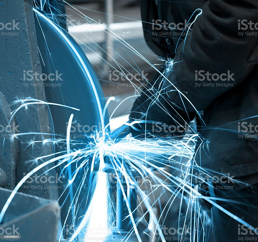 Emery in process in machinery workshop stock photo