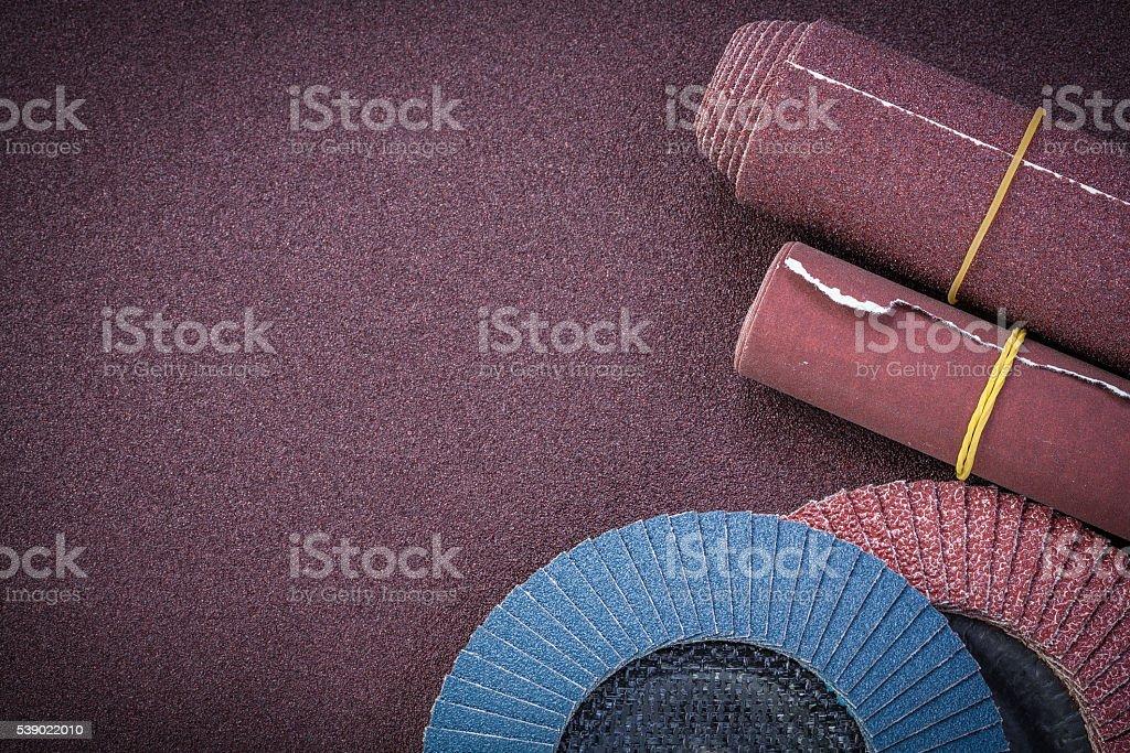 Emery paper flap grinding wheels on polishing sheet copy space stock photo