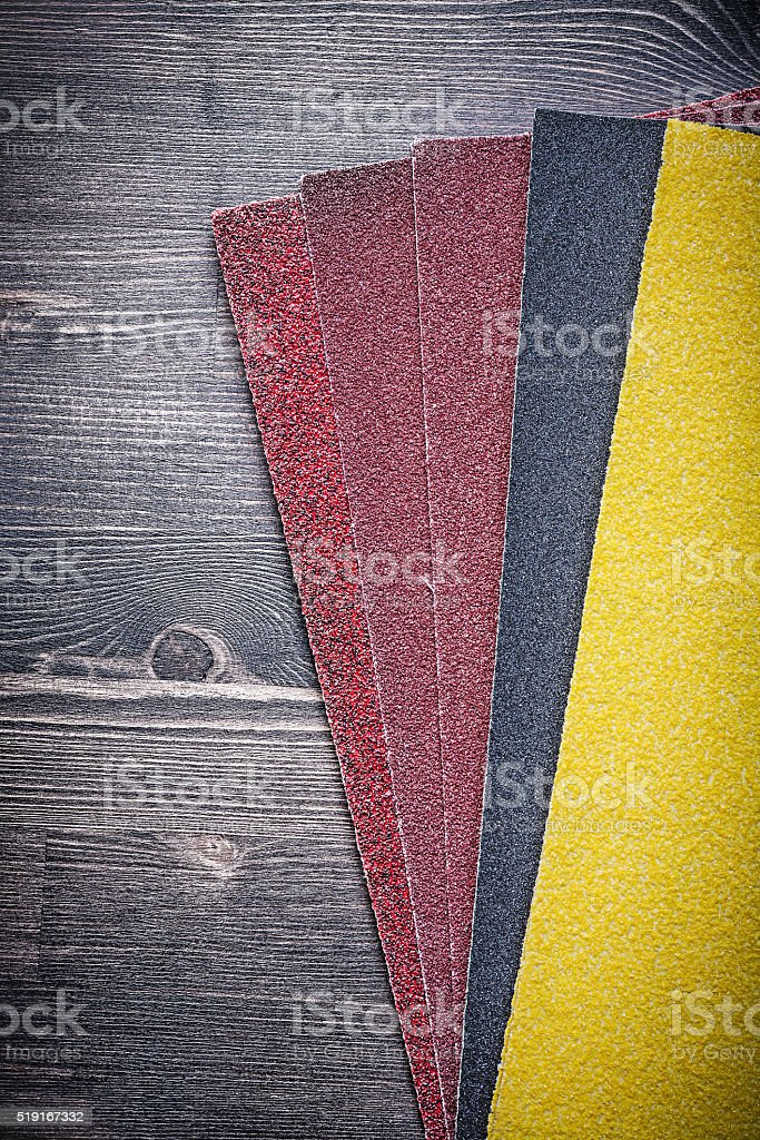 Emery paper on vintage wooden board abrasive tools stock photo