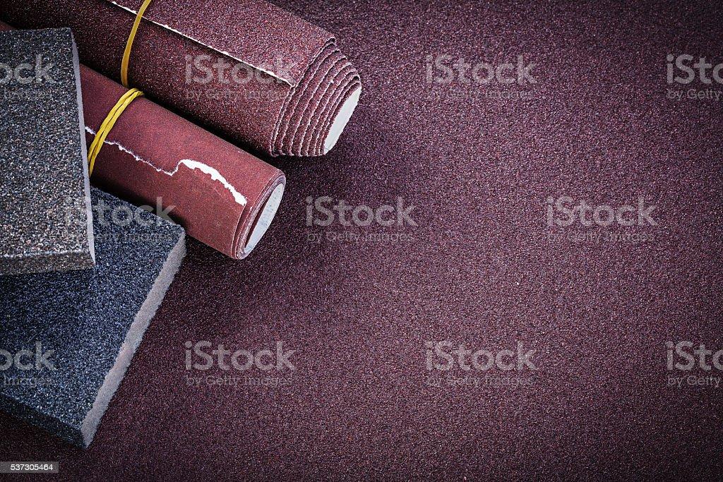 Emery paper rolls sanding sponges on polishing sheet abrasive ma stock photo