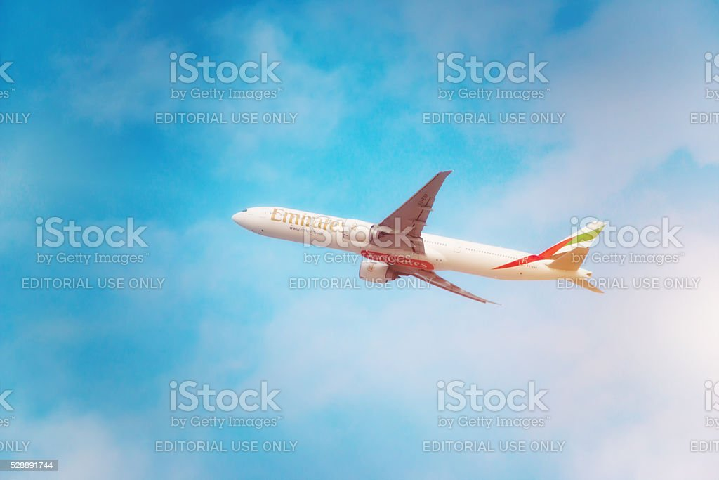 Emirates aircraft is taking off from DXB airport stock photo