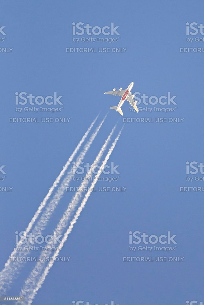 Emirates Airlines plane in the sky stock photo